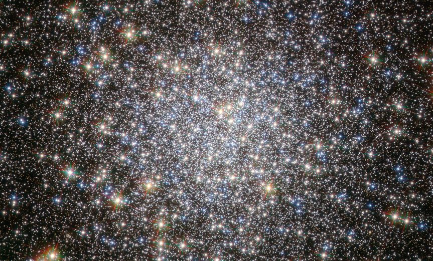 The globular cluster Messier 5, shown here in this NASA/ESA Hubble Space Telescope image, is one of the oldest belonging to the Milky Way. The majority of its stars formed more than 12 billion years ago, but there are some unexpected newcomers on the scene, adding some vitality to this aging population. Stars in globular clusters form in the same stellar nursery and grow old together. The most massive stars age quickly, exhausting their fuel supply in less than a million years, and end their lives in spectacular supernovae explosions. This process should have left the ancient cluster Messier 5 with only old, low-mass stars, which, as they have aged and cooled, have become red giants, while the oldest stars have evolved even further into blue horizontal branch stars. Yet astronomers have spotted many young, blue stars in this cluster, hiding amongst the much more luminous ancient stars. Astronomers think that these laggard youngsters, called blue stragglers, were created either by stellar collisions or by the transfer of mass between binary stars. Such events are easy to imagine in densely populated globular clusters, in which up to a few million stars are tightly packed together. Messier 5 lies at a distance of about 25 000 light-years in the constellation of Serpens (The Snake). This image was taken with Wide Field Channel of Hubble's Advanced Camera for Surveys. The picture was created from images taken through a blue filter (F435W, coloured blue), a red filter (F625W, coloured green) and a near-infrared filter (F814W, coloured red). The total exposure times per filter were 750 s, 400 s and 567 s, respectively. The field of view is about 2.6 arcminutes across.